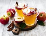 Apple cider  with cinnamon sticks - 238999886