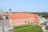 Old town of Warsaw city in Poland. Red facade of The Royal Castle, green heal. - 239013654