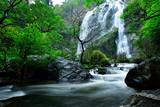 Beautiful great waterfall in tropical forest at Khlong Lan National park, Kamphaeng Phet, Thailand
