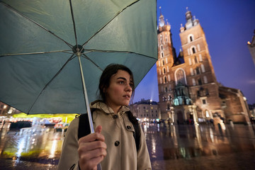 Woman with umbrella in Krakow