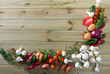 Natural wooden background with vegetables assortment and mushrooms