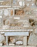 unusual random shapes stone wall closeup