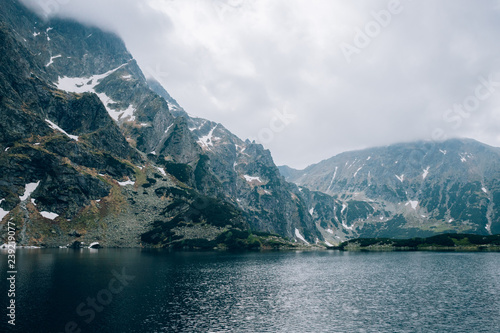 Pond in a mountain valley in cloudy weather Czarny Sraw