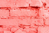 Texture, wall, concrete, living coral. It can be used as a background . Wall fragment with scratches and cracks