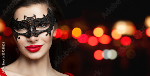 94d2d47f86d3 Perfect woman face in black carnival mask and red lips makeup on black  background with abstract