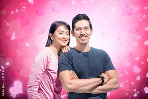Smiling asian couple with the woman lean back on the man shoulder - 239280461