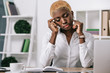 attractive  african american businesswoman sitting with closed eyes