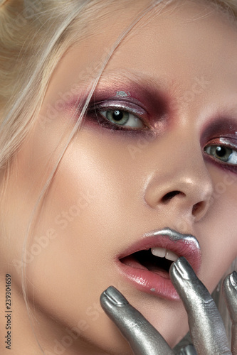 Close up beauty portrait of young woman with coral red and silver make up. Perfect skin and fashion makeup. Studio shot. Sensuality, passion, trendy youth makeup concept. - 239304659
