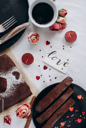 obraz lub plakat A cup of coffee and baked homemade pie, with heart with candle on on white background. Healthy homemade whole grain pie. Valentines day or mother's day