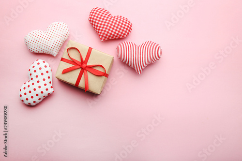Gift box with fabric hearts on pink background - 239389280