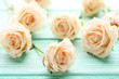 Bouquet of beige roses on mint wooden table