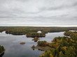 Aerial view of a beautiful lake in the forest with colorful trees during fall season. Taken in Grand Lake Flowage, Nova Scotia, Canada.