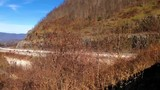 Smooth shot of mountains and highway at scenic overlook in North Carolina - 239442022