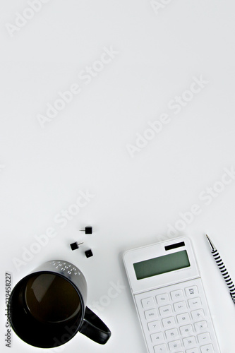 calculator and pen in white background - 239458227