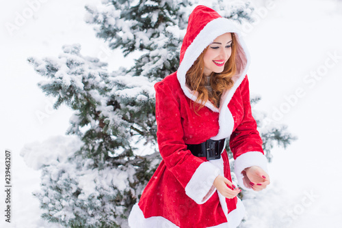 01e95341dbd63 Merry Christmas and happy holidays! Santa girl at snowy day. Babe enjoying  the game