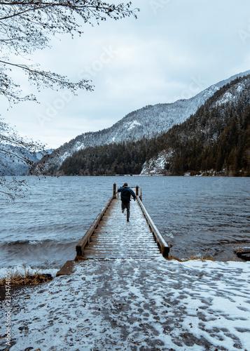 Acrylglas Pier fisherman running to lake