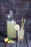 Lemonade with lemon, ginger, cucumber, mint. Summer refreshment drink. bottle and glass