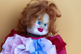 Creepy clown doll in colorful clothes