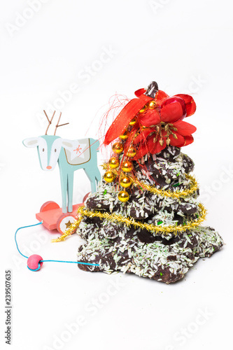 New Year Christmas card. Gingerbread Christmas tree Cookies decorated with sweets, coconut. copy space