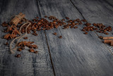 Coffee beans on wood background. Dark still life, top view