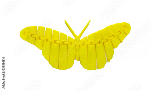 Bright light yellow object in shape of butterfly toy printed on 3d printer isolated on white background. Fused deposition modeling, FDM. Concept modern progressive additive technology for 3d printing.