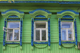Windows with carved frames on wooden house in Russian village