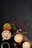 Cappuccino with milk and nuts and marshmallow. On a black stone background. Top view. Free copy space. © Yaruniv-Studio