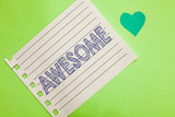 Word writing text Awesome. Business concept for Something spectacular amazing fantastic extremely impressive good Notebook piece paper reminder heart romantic messages green background