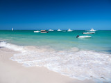 Caribbean destinations with boats in the sea