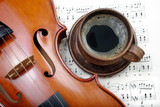 a cup of coffee, neck of violin and notes.