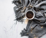 Cup of coffee, scarf and garland  - flat lay