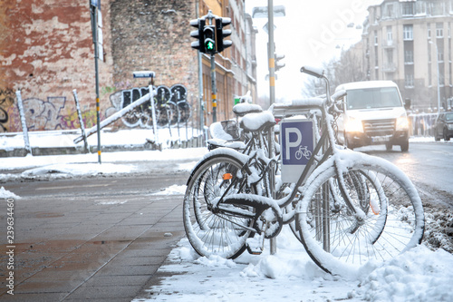Bicycle covered with snow. City and transport - 239634460