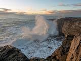 Huge waves crashing on rocks at sunset, storm, West coast of Ireland.