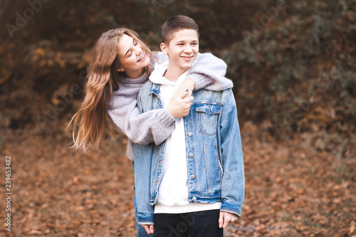 Happy Love Teen Couple Having Fun Outdoors Wearing Stylish Denim