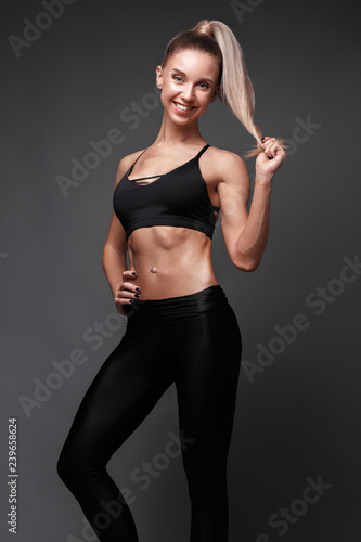 d87efe0e6f Sports girl with pumped muscles,beauty body in a tracksuit, leading a  healthy lifestyle