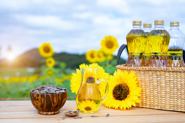 Wicker basket with sunflower, sun flower seed and bottles of oil on the background of the farm