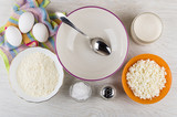 Spoon in bowl, ingredients for preparation cottage cheese pancakes - 239717285