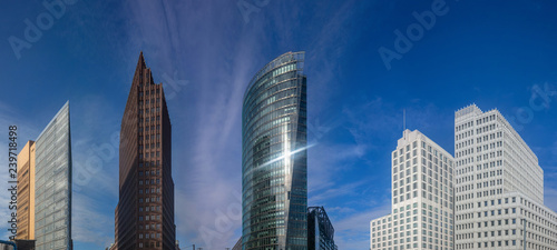 Potsdamer platz in Berlin, Germany. Destination for business at skyscrapers offices. Blue sky background, banner.