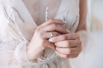 bride touches the engagement ring