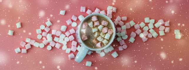 Cocoa drink with marshmallows isolated on pink or coral background, top view. Christmas hot drink. Banner. © Inga