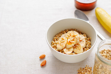 Bowl of oatmeal with banana slieces