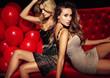 Leinwanddruck Bild - Two sexy girls on lounge. Celebrating.