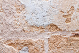 Rough weathered natural old stone wall background, various colored