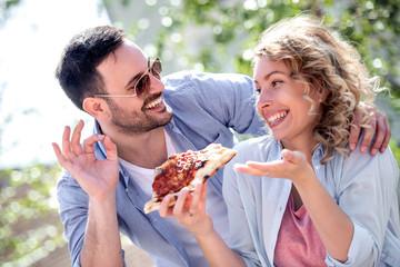 Happy couple sharing pizza © ivanko80