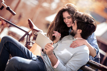 Young couple sitting outdoors © ivanko80