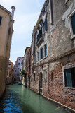 View of Venice with canal and old buildings, Italy