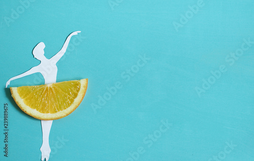 Orange fruit background with ballet dancer, citrus exotic fruit, healthy food, summer.  - 239889675