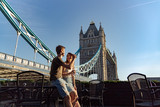 couple enjoy sunset next tower bridge
