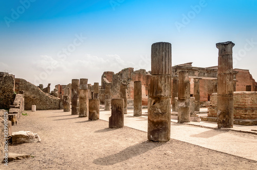 Pompeii ruins: destroyed stone columns at archaeological site