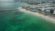 Drone shot of beautiful beach of Playa del Carmen, resorts and people enjoying at beach of clear sea, Mexico